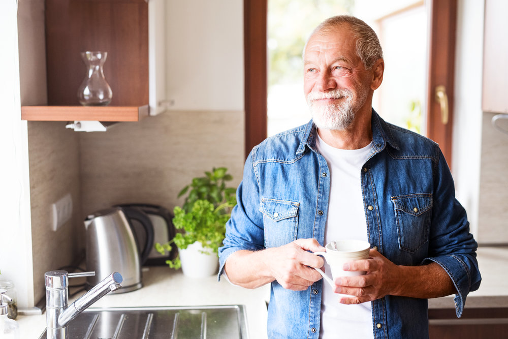photodune-21921412-happy-senior-man-holding-a-cup-of-coffee-in-the-kitchen-xxl.jpg