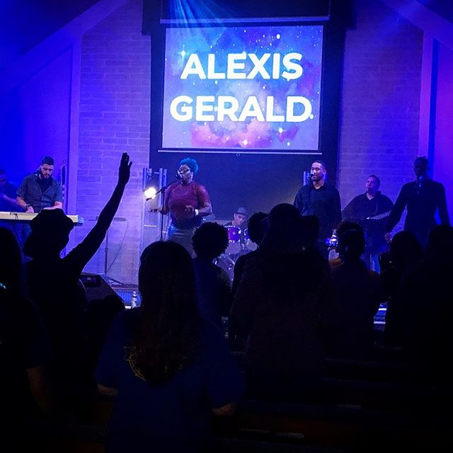 Alexis and Malachi getting the crowd into praise and worship.