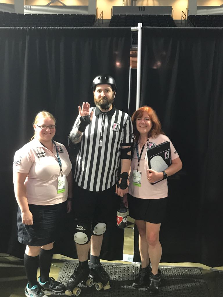 Mortricia with other Dames officials at the 2017 WFTDA Division 1 Playoffs in Seattle, WA