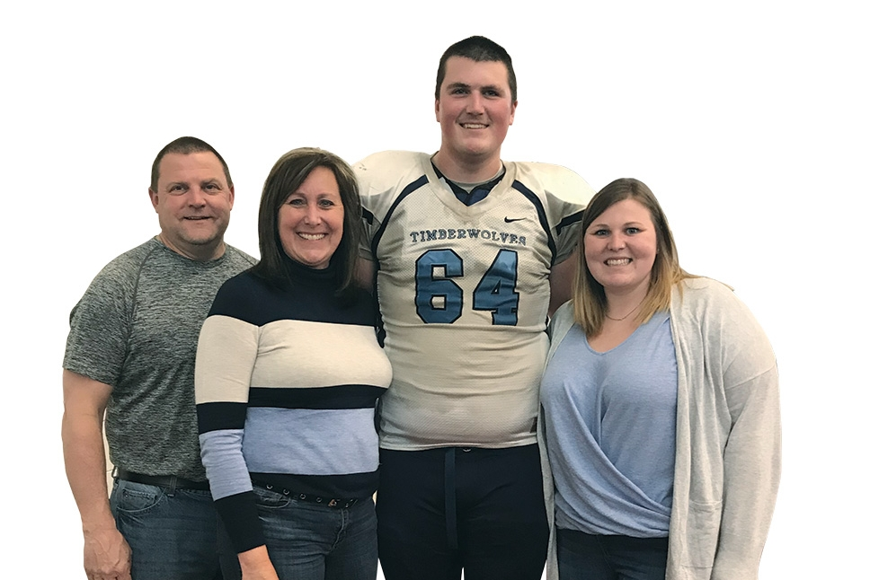 Thanks to support from the Northwood University Alumni Legacy Endowed Scholarship, Greg, Michelle, Derek, and Morgan Waller's team spirit is also family spirit as they cheer on the Timberwolves and their favorite offensive lineman