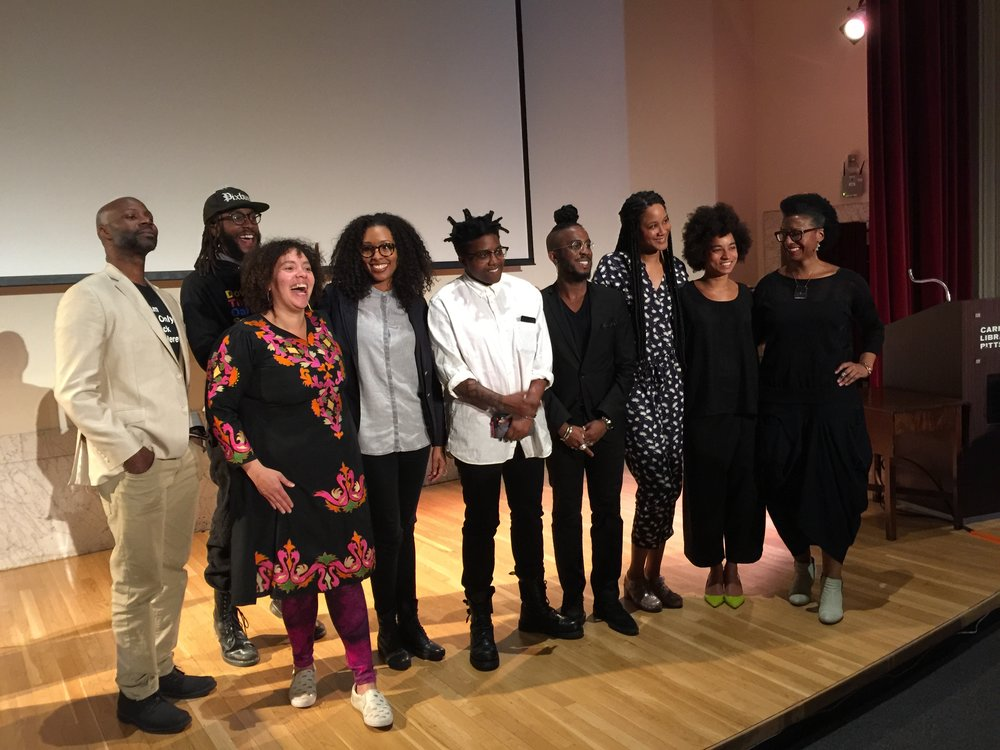 The first By Any Means   symposium, Carnegie Library Lecture Hall, April 23, 2016 .  Left to right: Nathaniel Donnett, Alisha Wormsley, D.S. Kinsel, Taylor Renee Aldridge, Tiona Nekkia McClodden, Ikechukwu Casmir, Jessica Lynne, Rujeko Hockley, and Kilolo Luckett.   Courtesy of Kilolo Luckett.