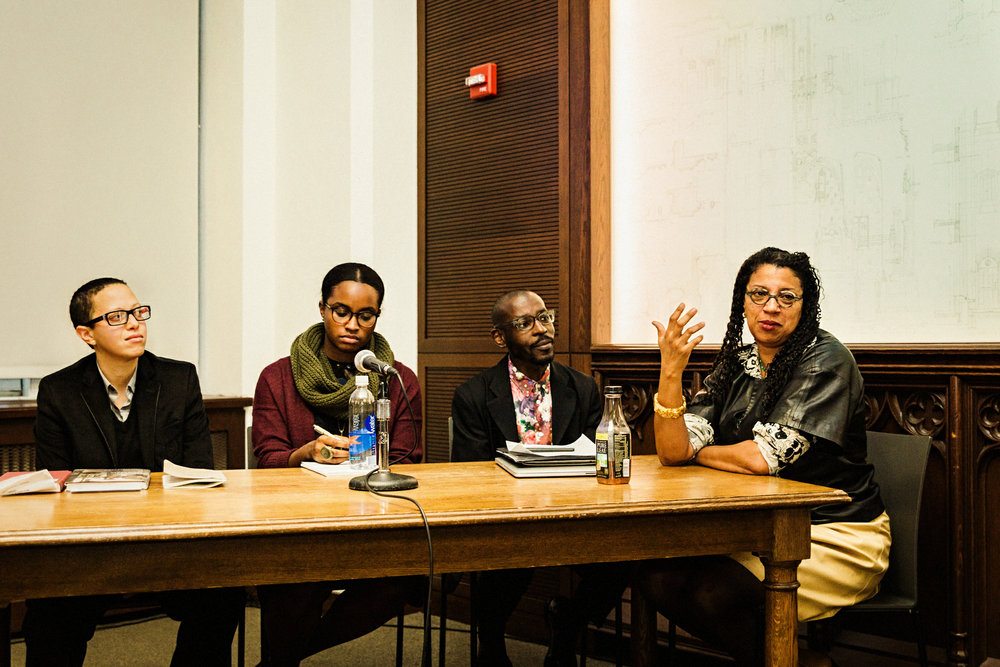 """Speakers at the University of Pittsburgh's """"Why Does Black Art Matter Now?"""" symposium, December 2016. From left to right: designers Mitch McEwen, Imani Day, and Mario Gooden, and poet Robin Coste Lewis. Photo by Heather Kresge."""