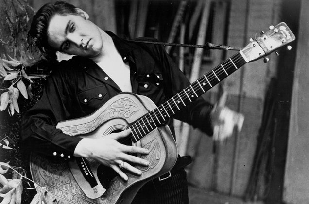 Elvis-Presley-portrait-with-an-acoustic-guitar-1956-billboard-1548.jpg