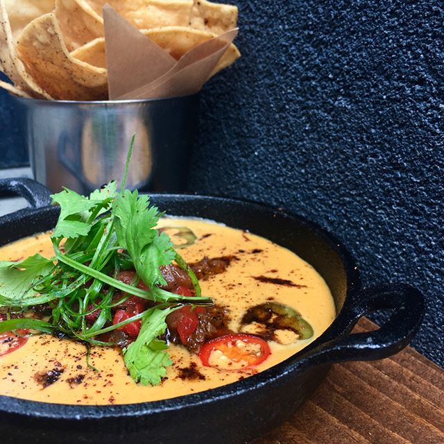 Set That Base For Cinco de Mayo 🇲🇽 Queso Fundito AKA Melted Cheese Dream  #LCsouthcentral & #LCuptown - rolling out everywhere real soon ------------- Roasted Pepper Salsa Pickled ChilliesScallons Chipotle Hot Sauce Mexican Chorizo OR Mushroom #veggie Tortilla Chips