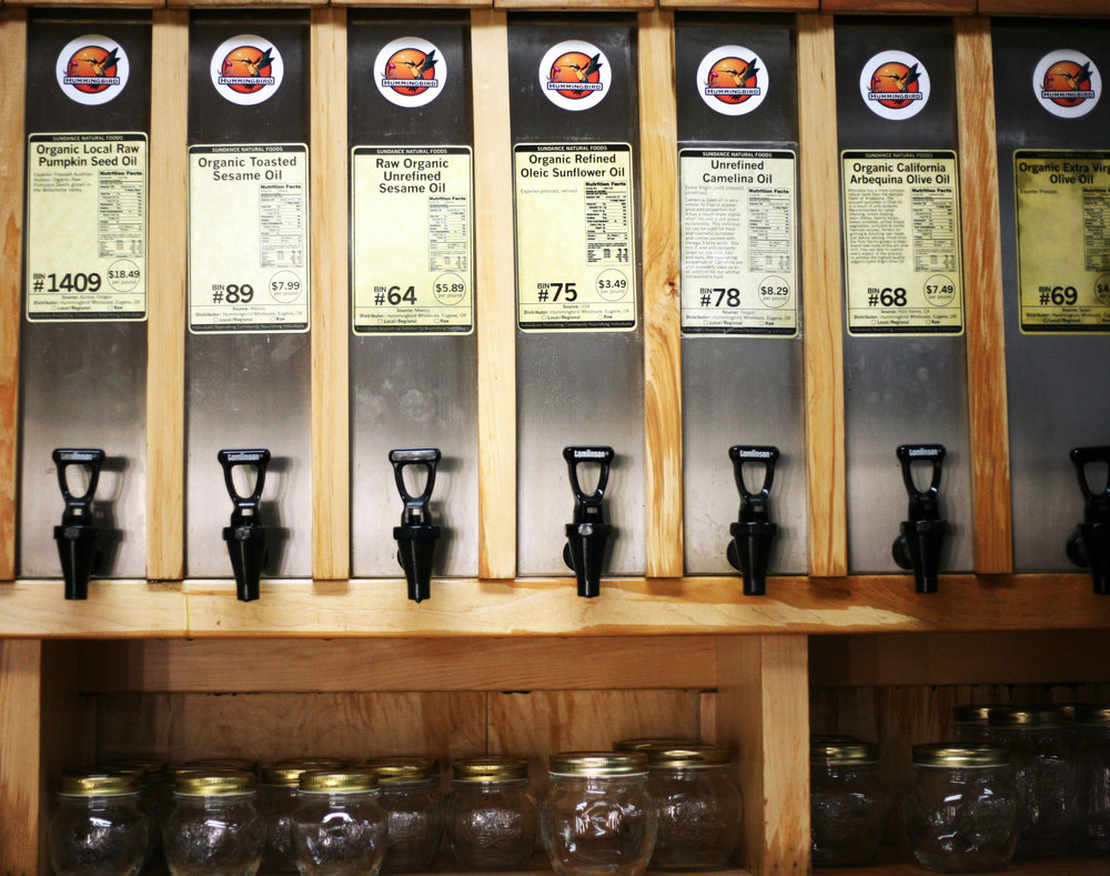 Sundance Natural Foods has a variety of products available in bulk, including various types of oils for cooking. They also have shelves lined with assorted sizes of mason jars to take your bulk items home in and then reuse.