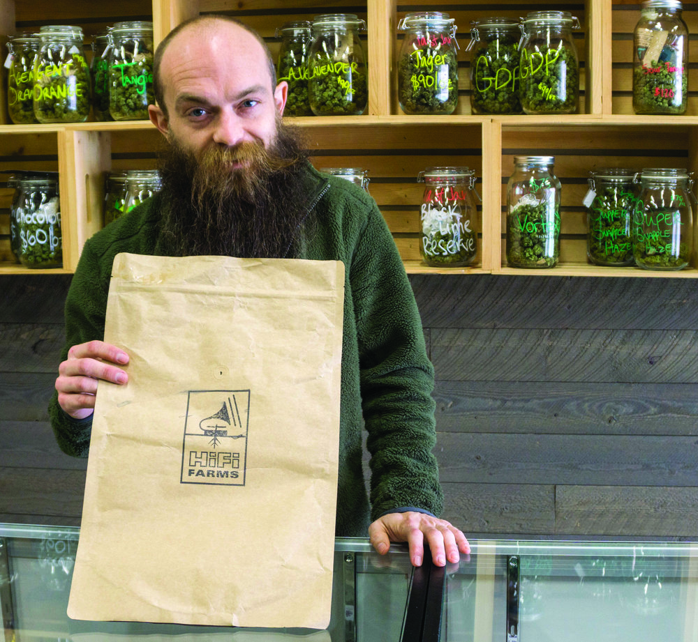 "Bj Harold, an employee at Oregon Cannabis Outlet, showcases an alternative hemp fiber bag. ""I've only seen farmer use these,"" he said."