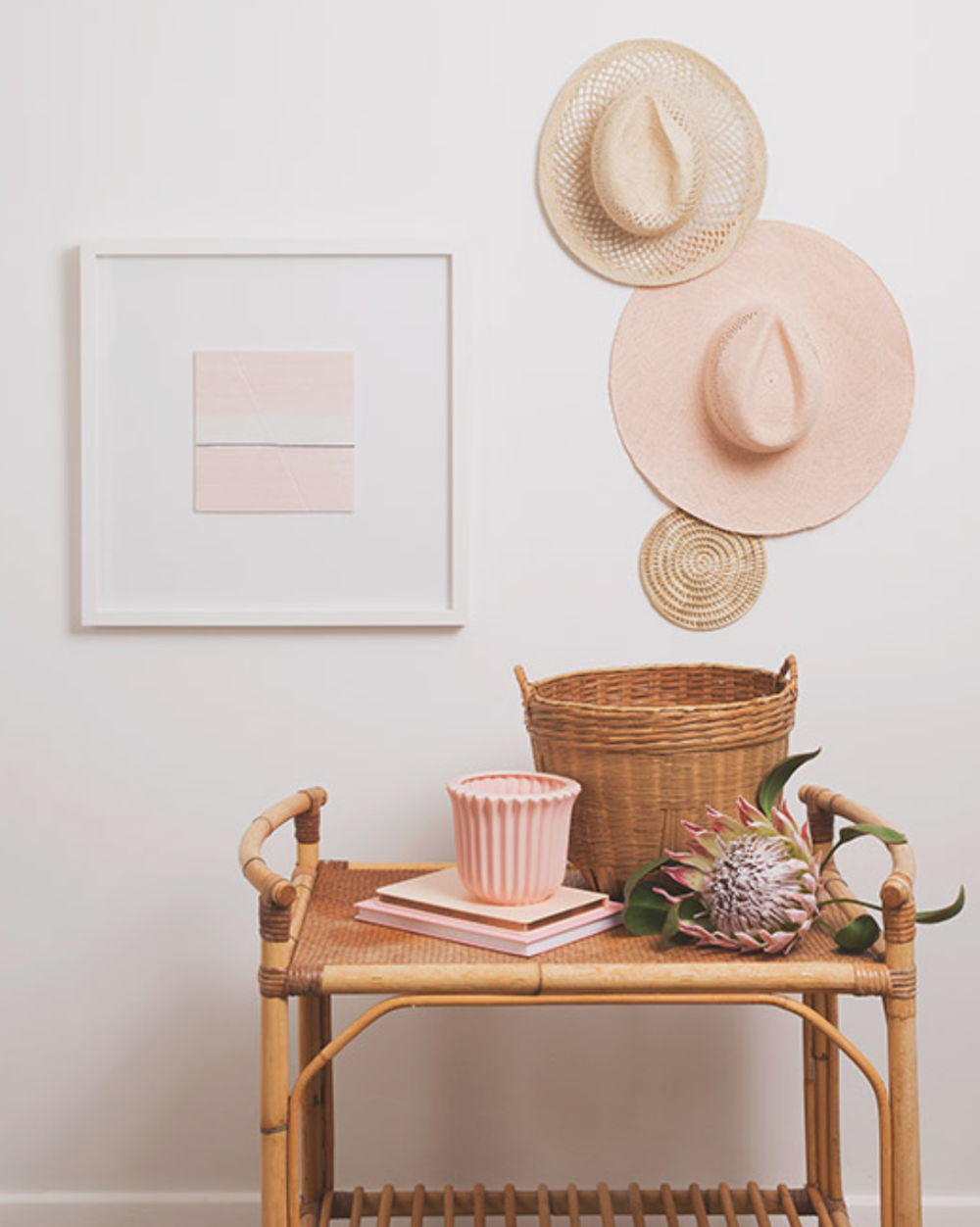 This vignette has a double dose of texture. Cutsie hats arranged over the rattan bar cart is obviously adorbs, but take note of the  Jane Denton  fiber art to the left. Her stuff is so perfectly minimal, textural and modern. Love it all. Check her out!