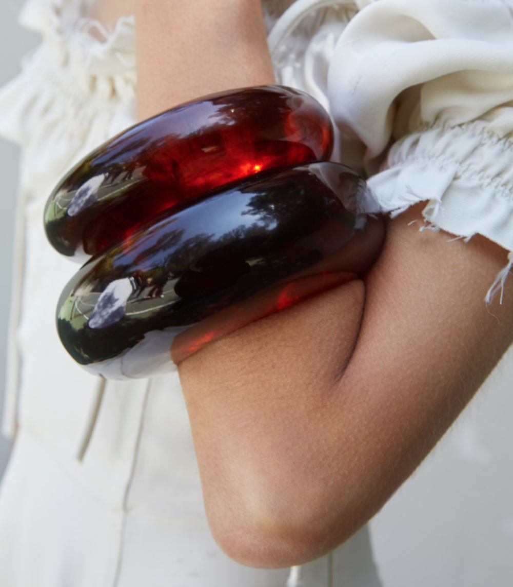 This amber acrylic bangle from  Cult Gaia  is EXACTLY what I'm talking about!
