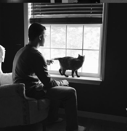 Black and White Picture Of Loby and Cat by the Window