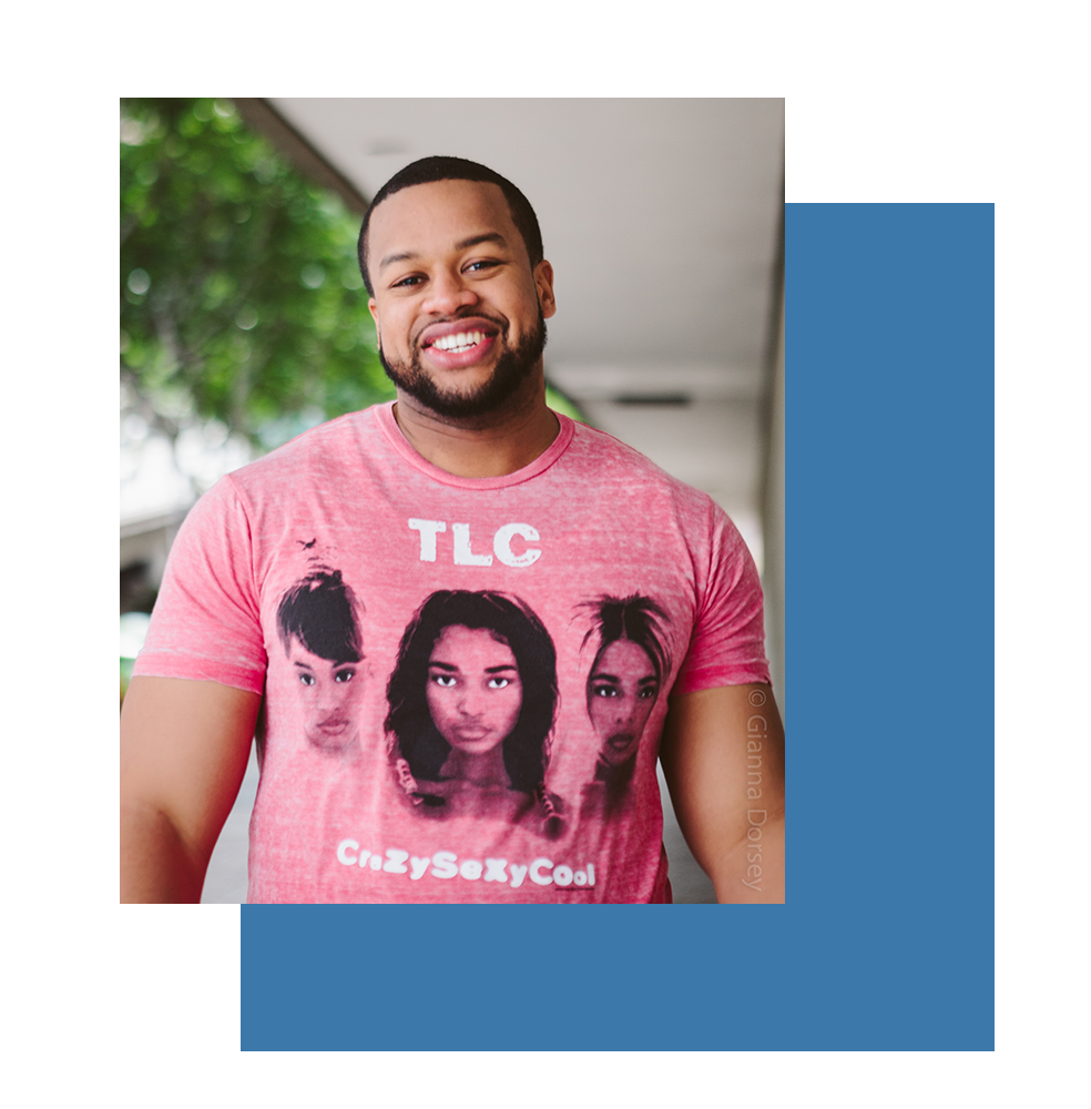 Image of Dorian smiling with pink TLC shirt