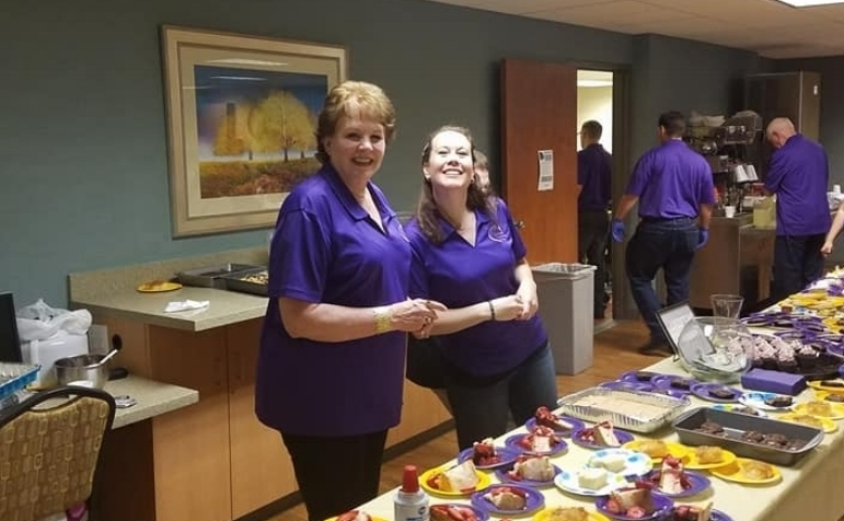 choir members serving dessert at our summer cabaret fundraiser.