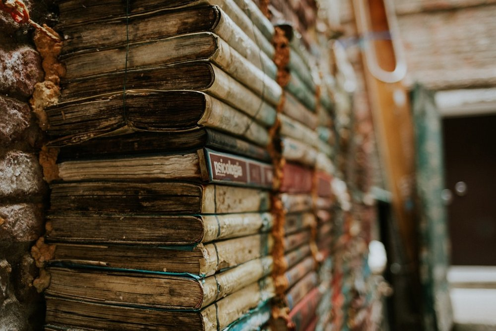 karina napier creative portland maine stacked books unsplash.jpeg