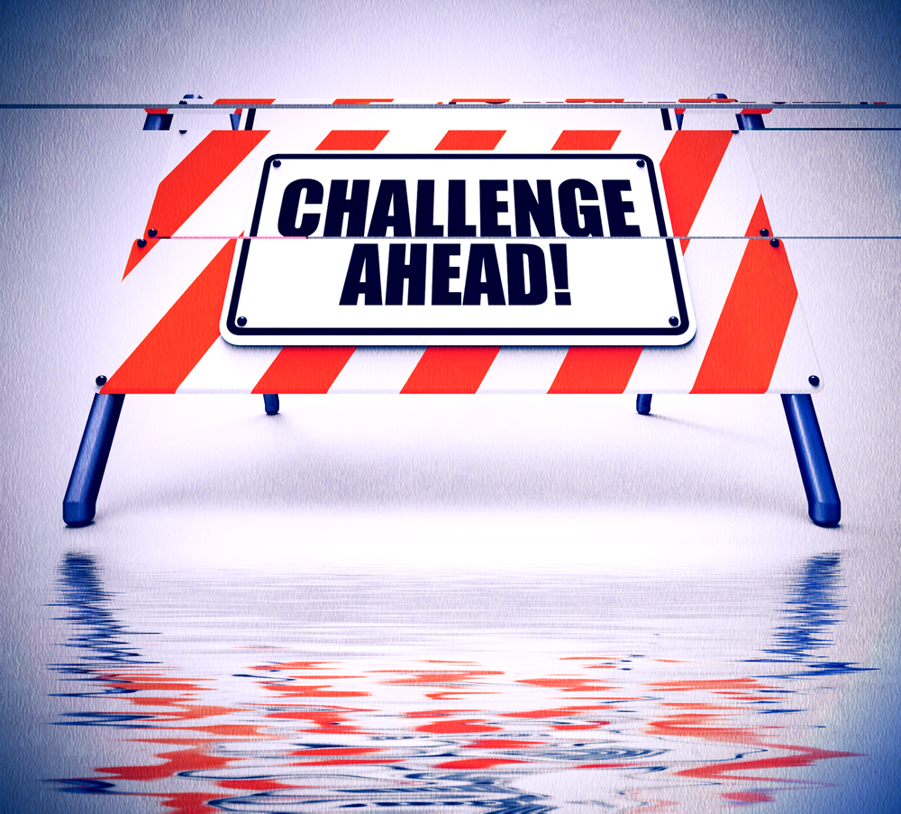 kozzi-25840358-Challenge_Ahead_Sign_Displays_to_Overcome_a_Challenge_or_Difficu-2050x1853_edited-1.png