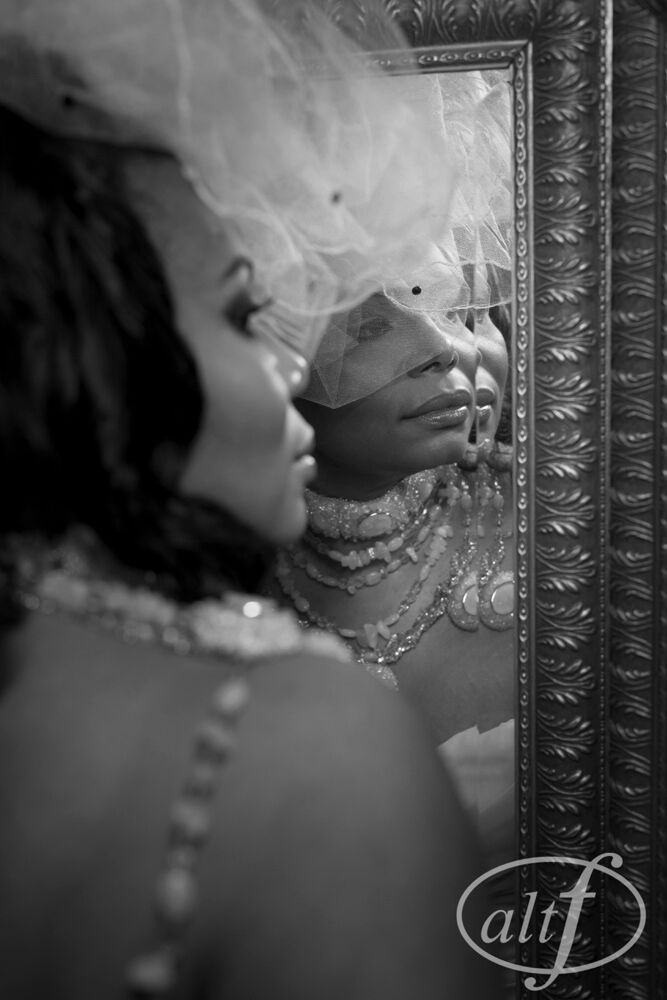 Bride on her wedding day with hair piece