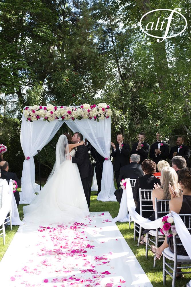 backyard-wedding-ceremony-first-kiss.jpg