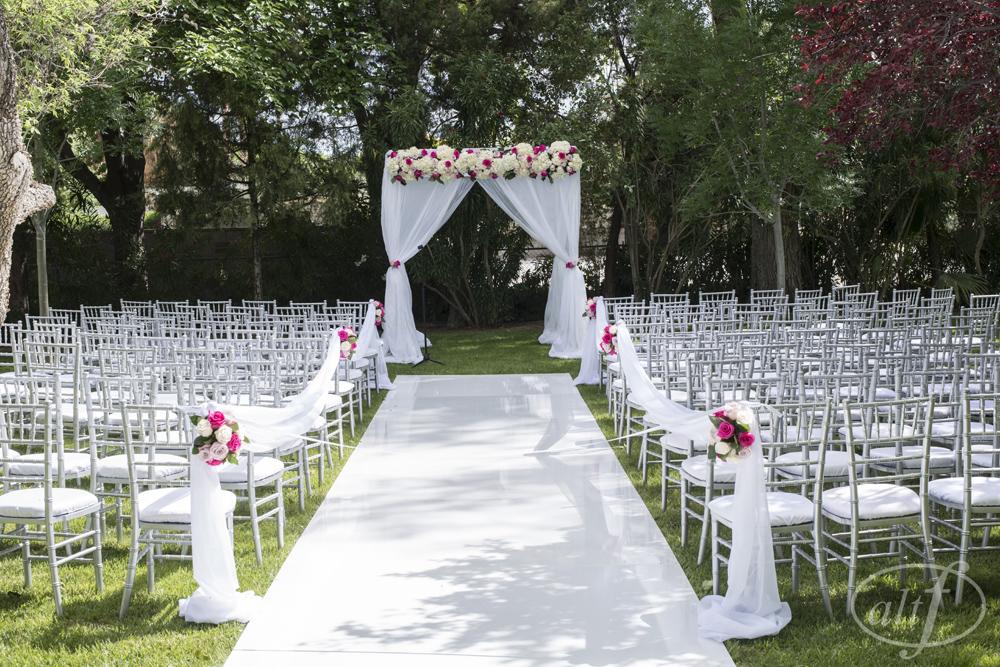 backyard-wedding-ceremony-white-fabric-altar.jpg