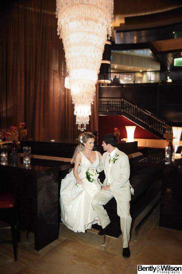 bride and groom red rock chandelier