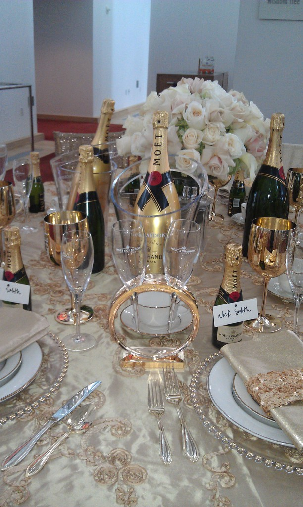 gold wedding reception table with moet