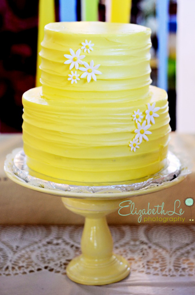 yellow two tier buttercream cake