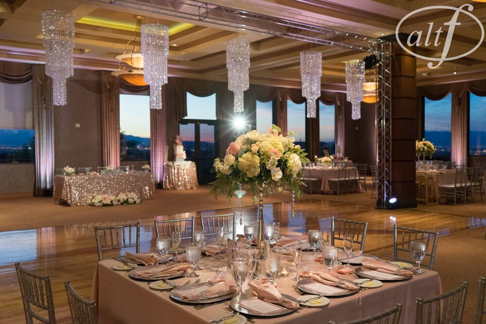 wedding reception with crystal chandeliers