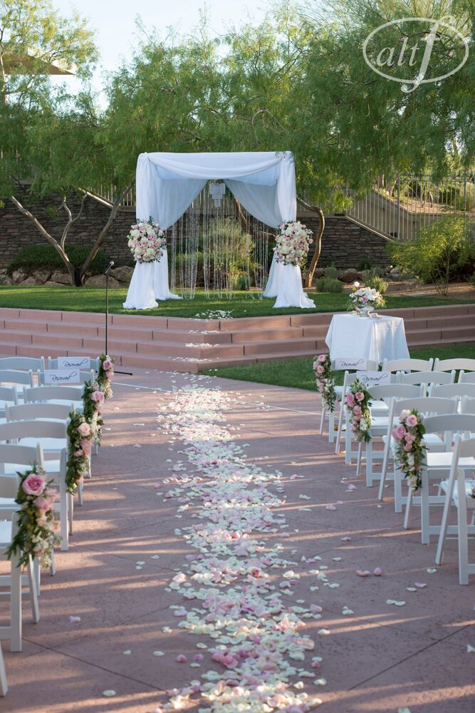 white and blush pink ceremony at DragonRidge Country Club