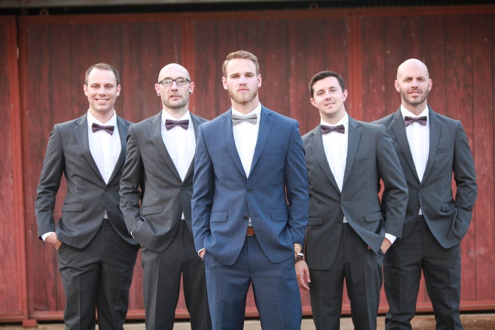 Groom and Groomsmen in suits and bowties