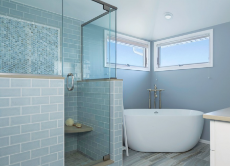 Modern bathroom with blue walls and plunge bath