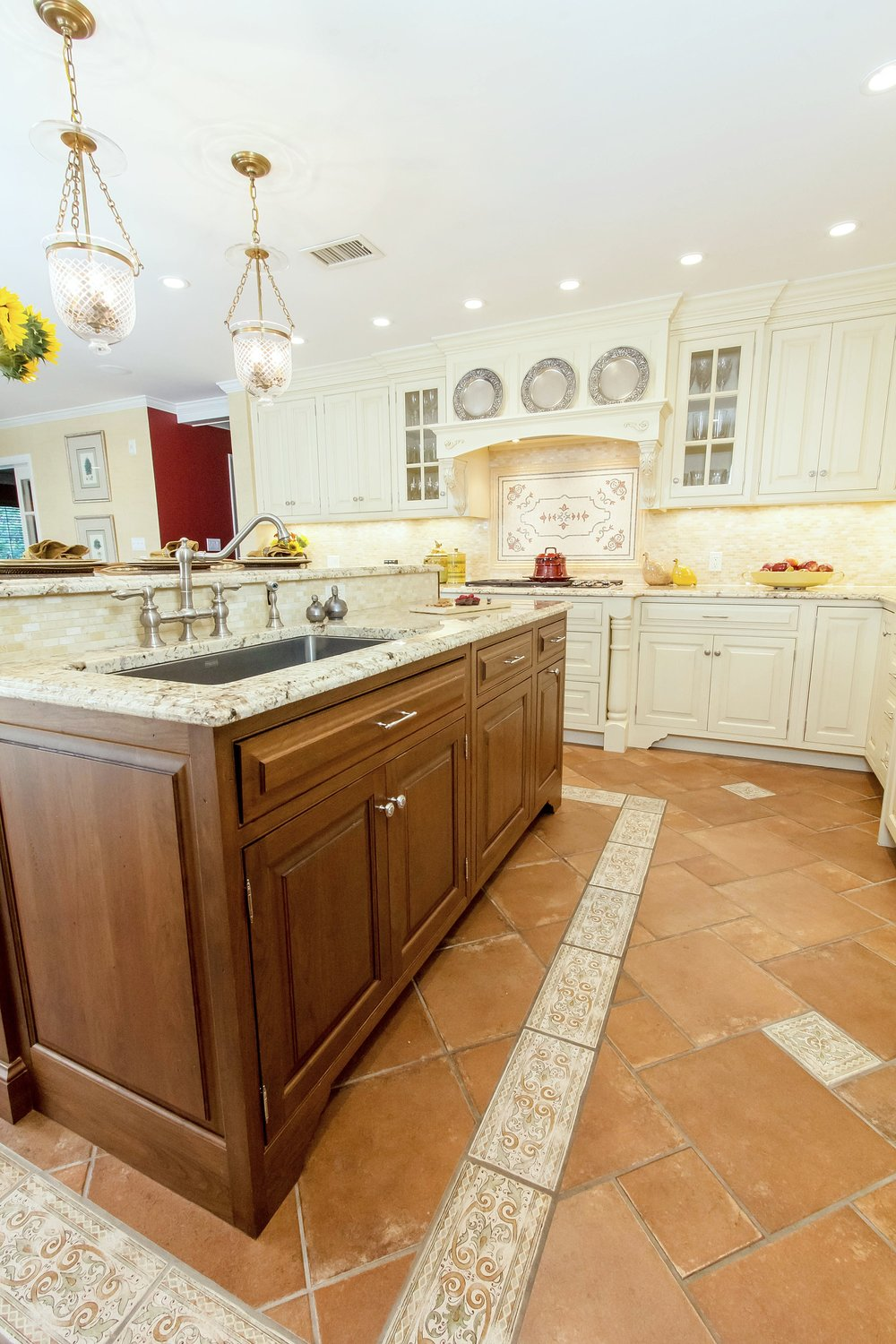 Traditional stye kitchen island with brown wood cabinets