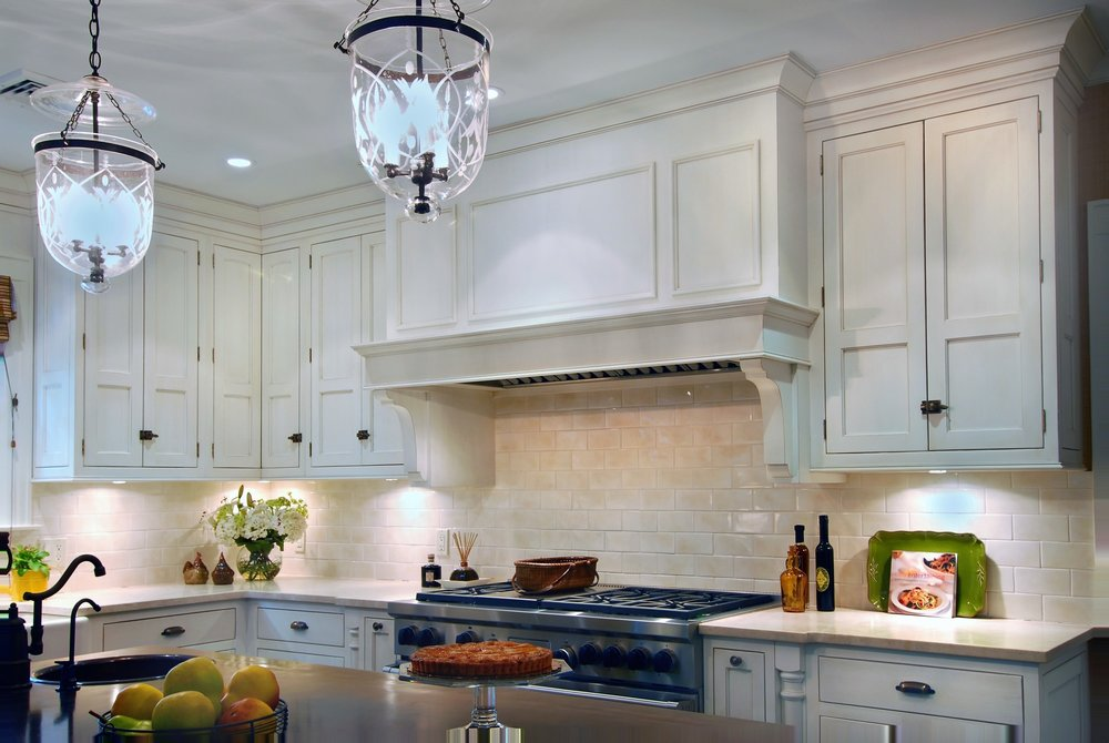 Traditional style kitchen with stainless steel range