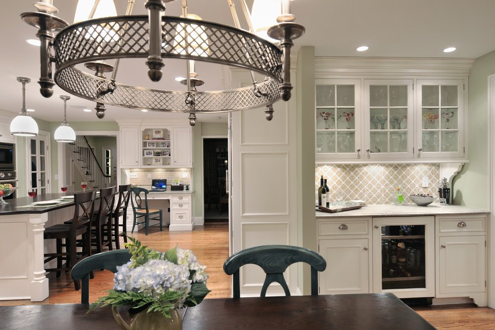 Traditional style kitchen with glass cabinets