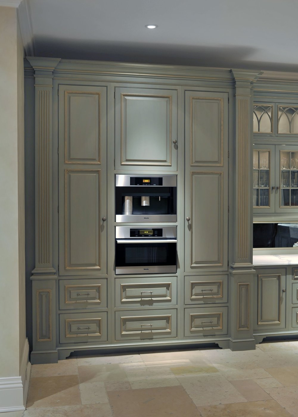 Traditional style kitchen with large closed door cabinet