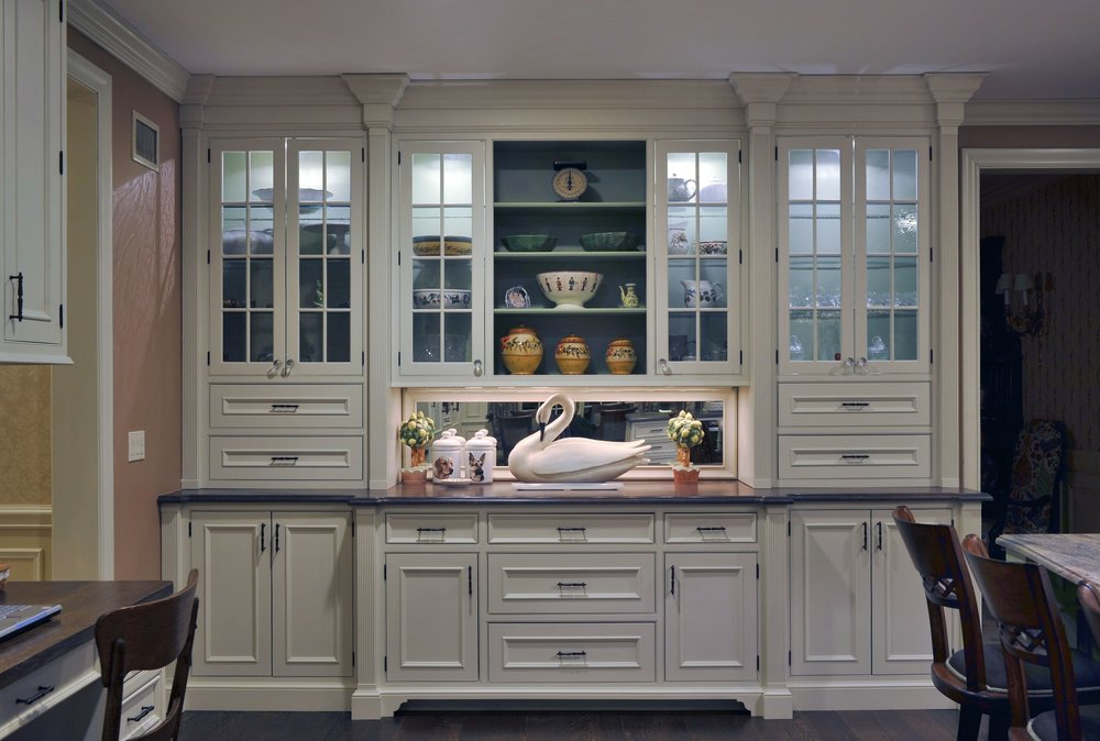 Traditional style kitchen with glass door white cabinets