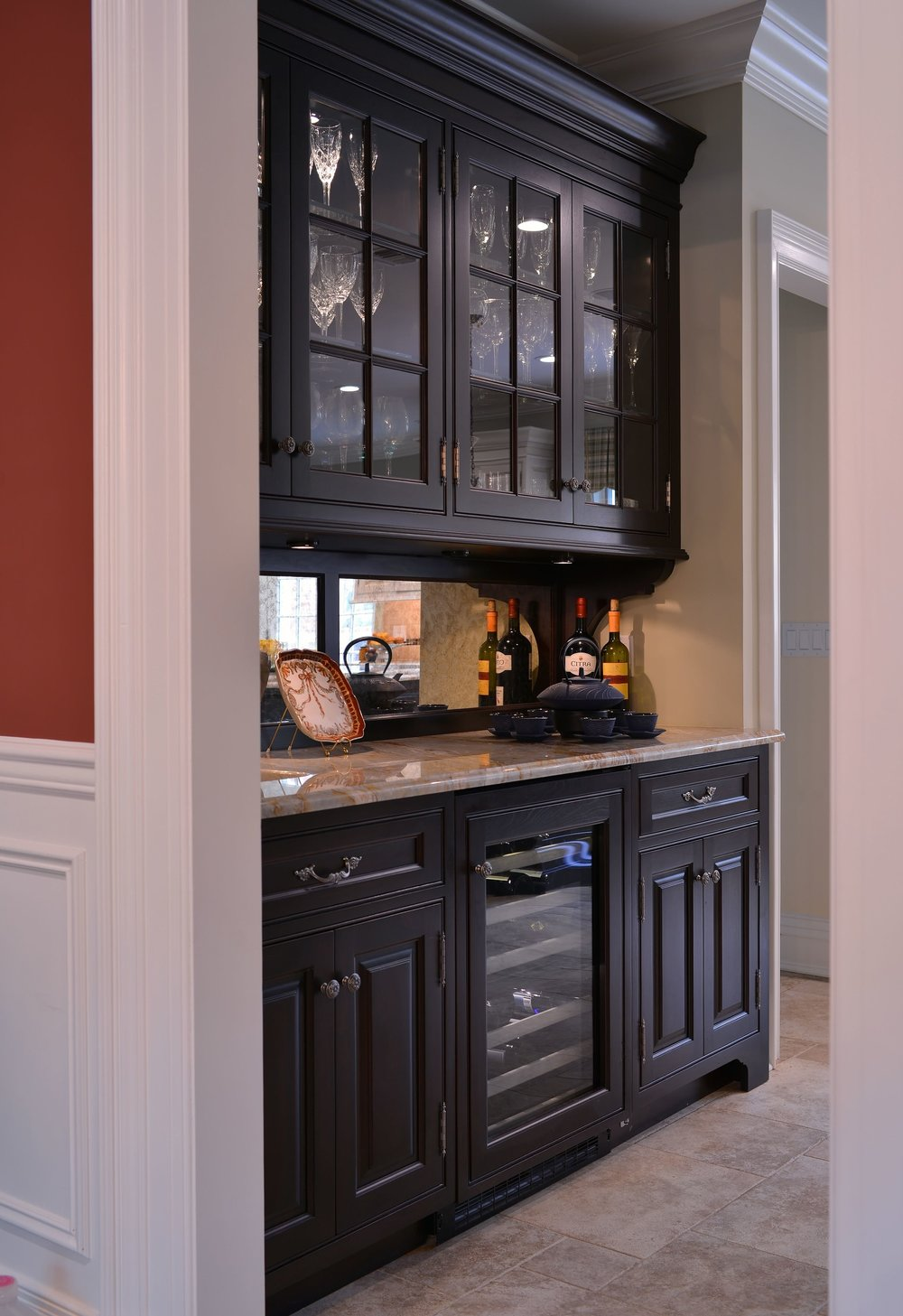 Traditional style kitchen with wine glass storage