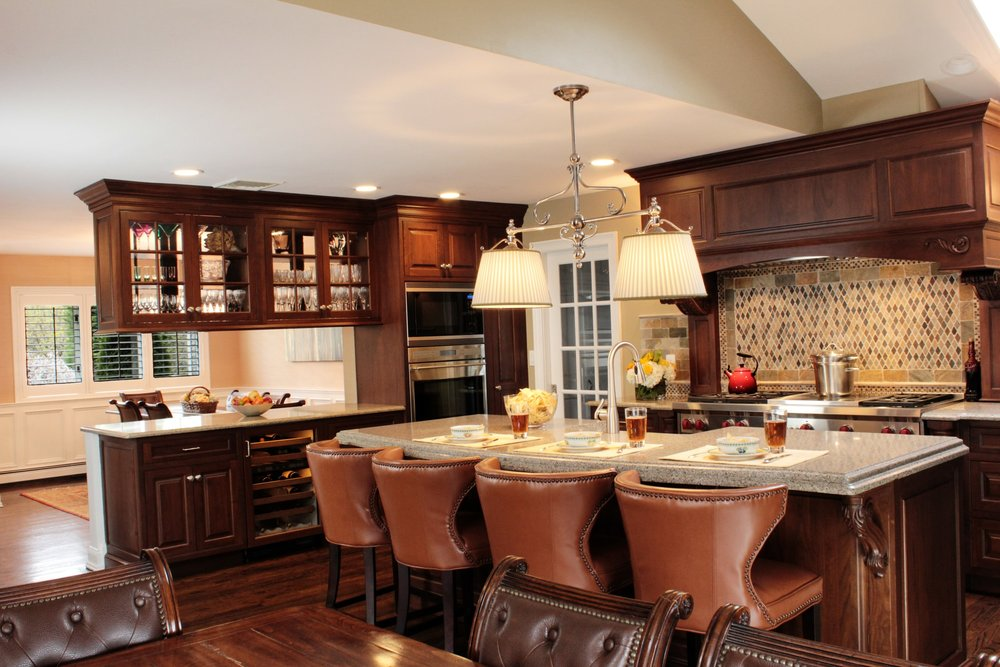 Traditional style kitchen with island bar and glass wine cabinet
