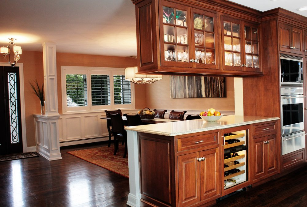 Traditional style kitchen with wooden floor and carpeted dining room