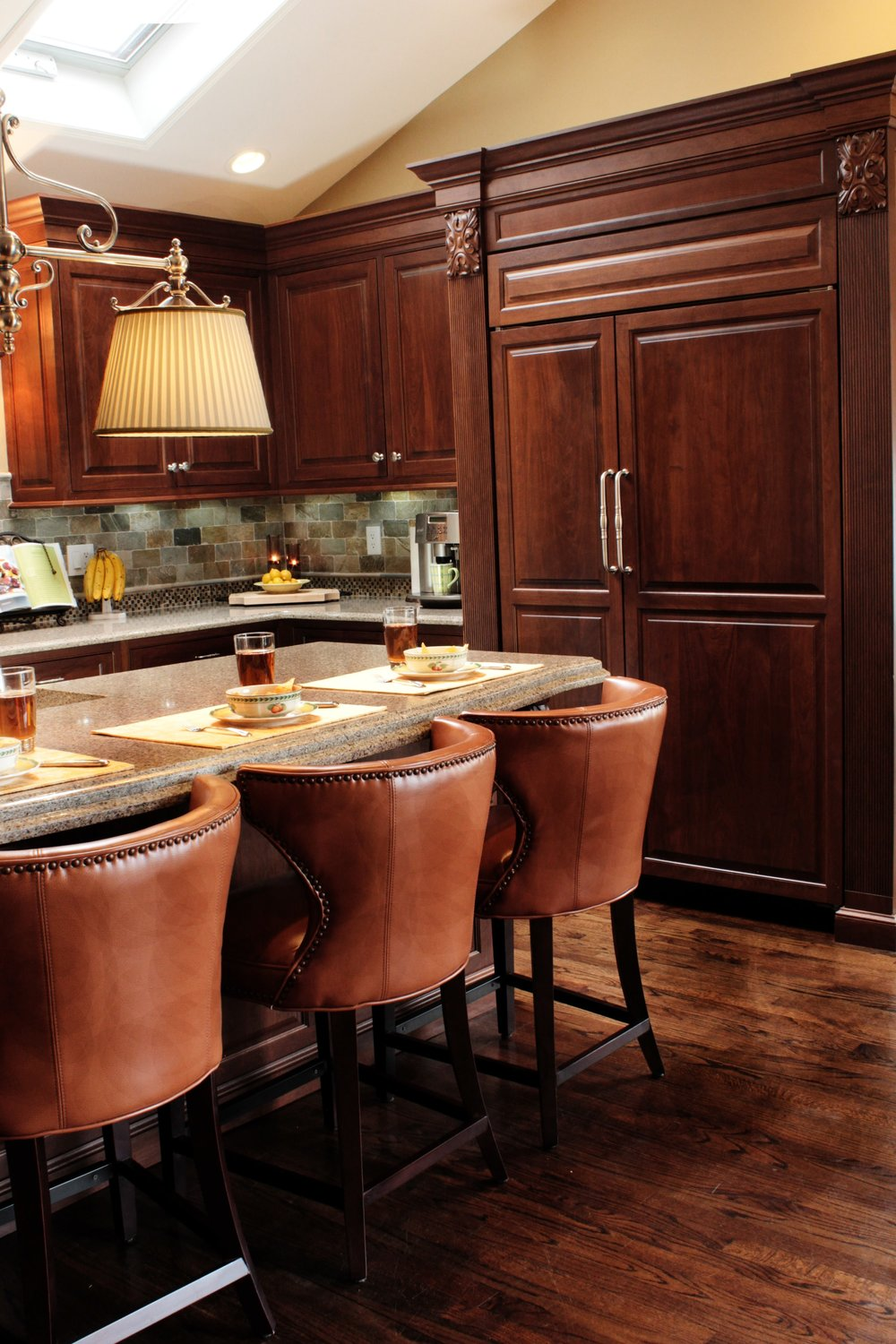 Traditional style kitchen with leather chairs