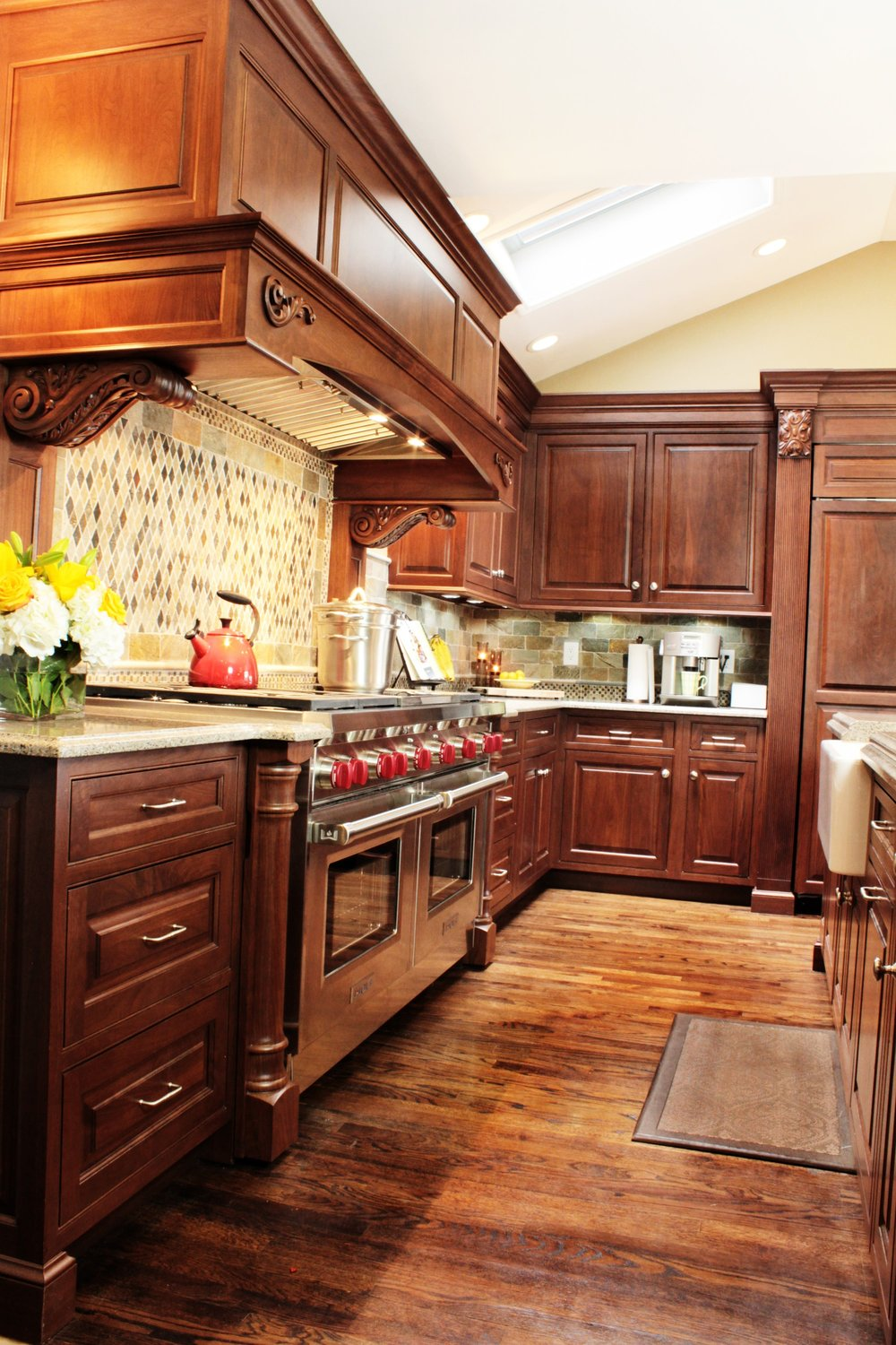 Traditional style kitchen with rustic style wooden floors