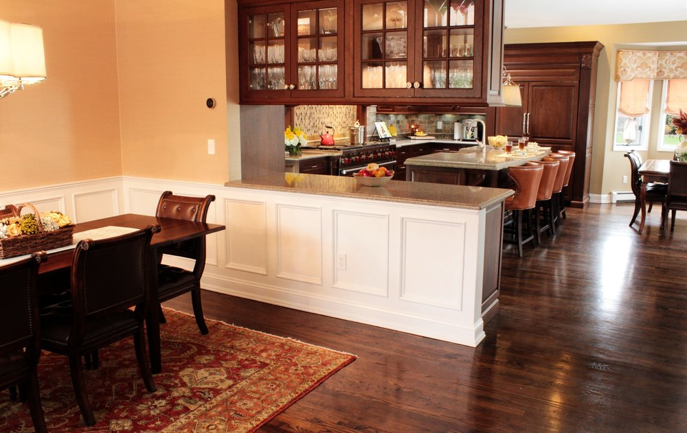 Traditional style kitchen with hanging wine glass cabinet