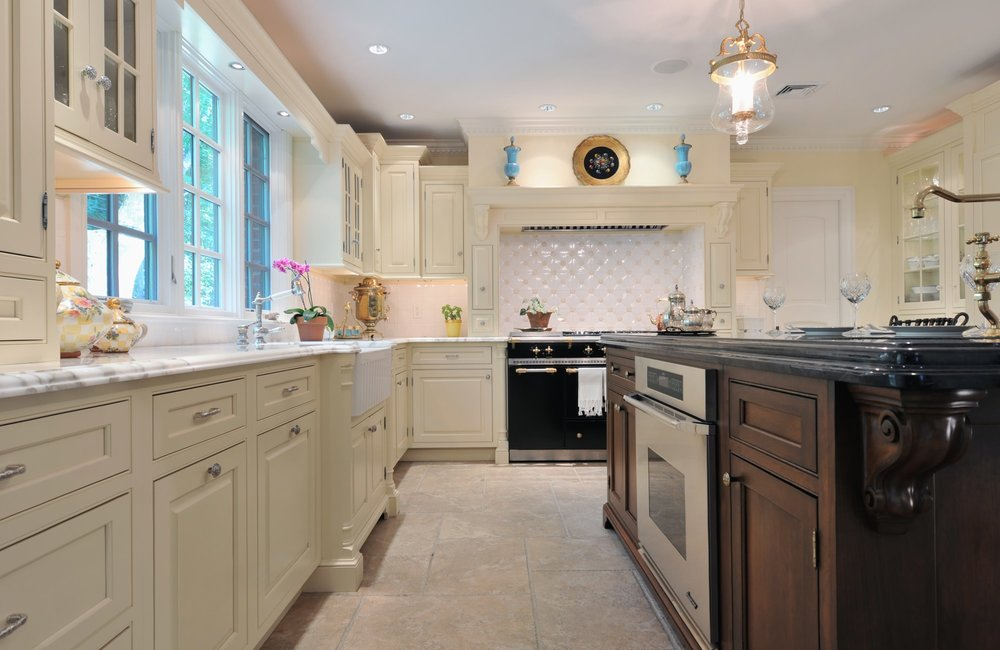 Traditional style kitchen with white french windows