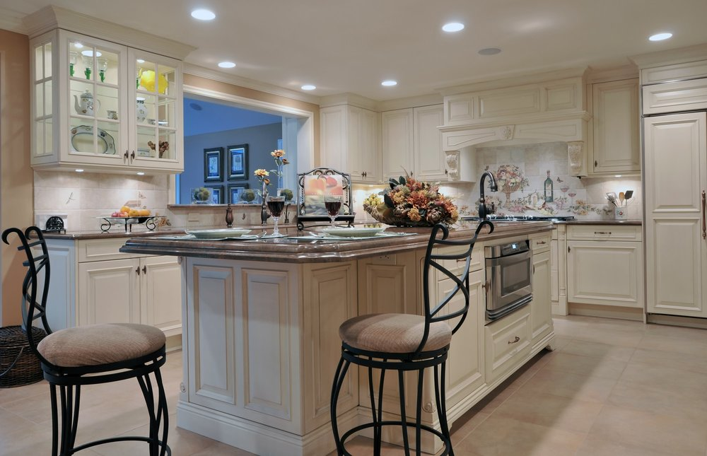 Traditional style kitchen with two chairs on kitchen island