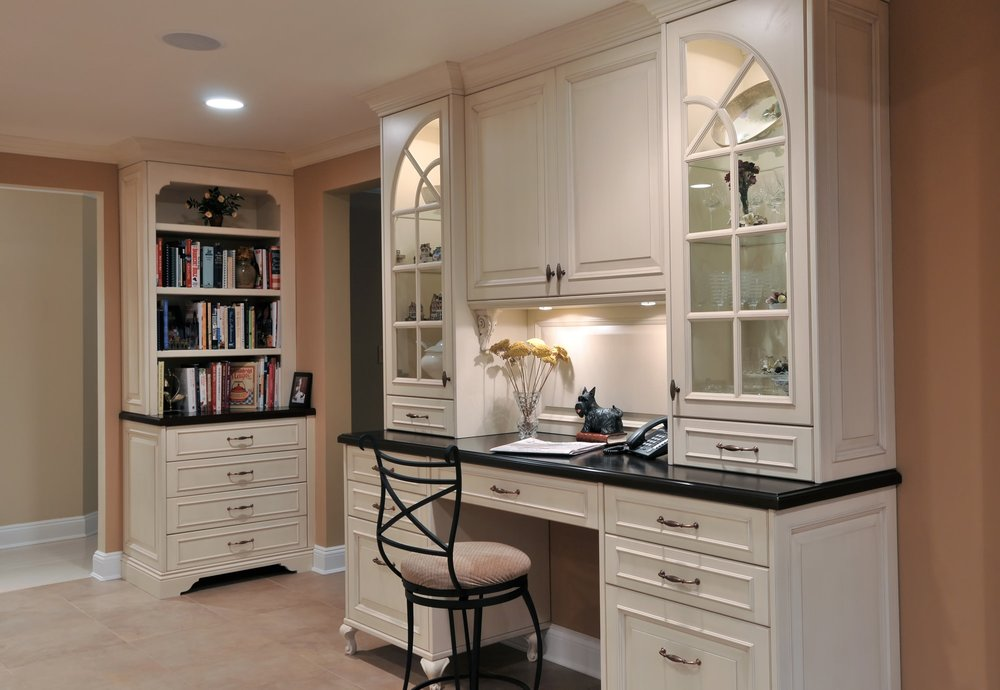 Traditional style kitchen with bookshelf and work table