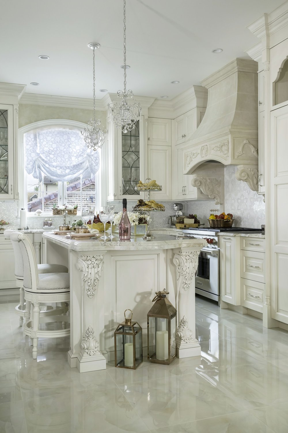 Traditional style kitchen with two small crystal chandeliers