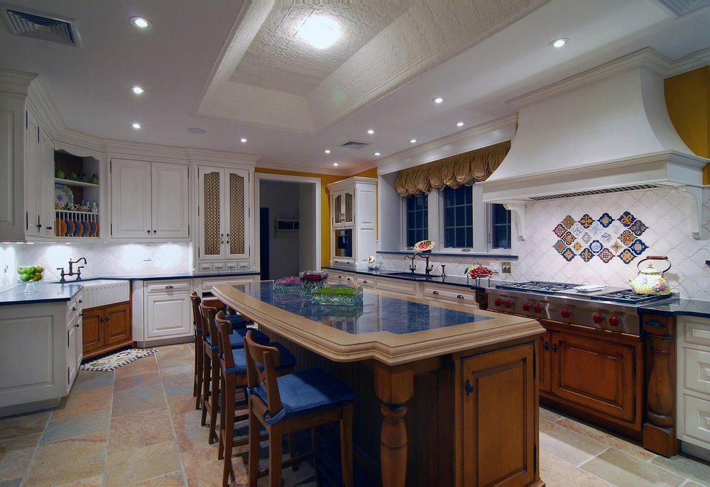 Traditional style kitchen with colorful tile design