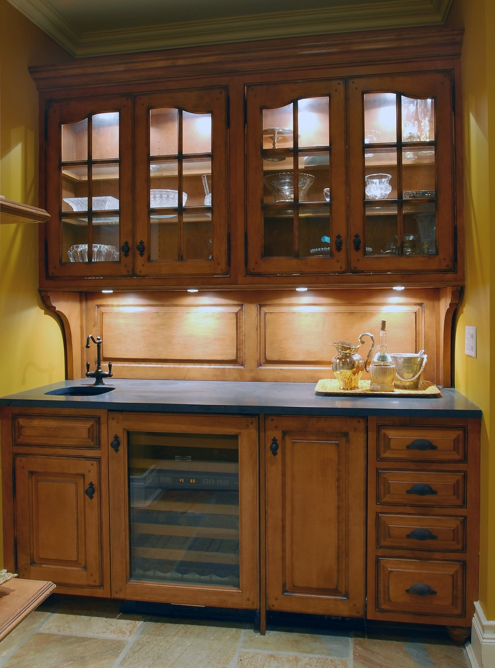 Traditional style kitchen with large wooden cabinet