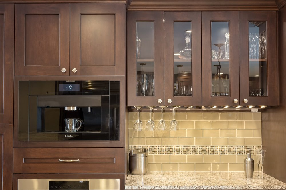 Traditional style kitchen with upper wine glass cabinet