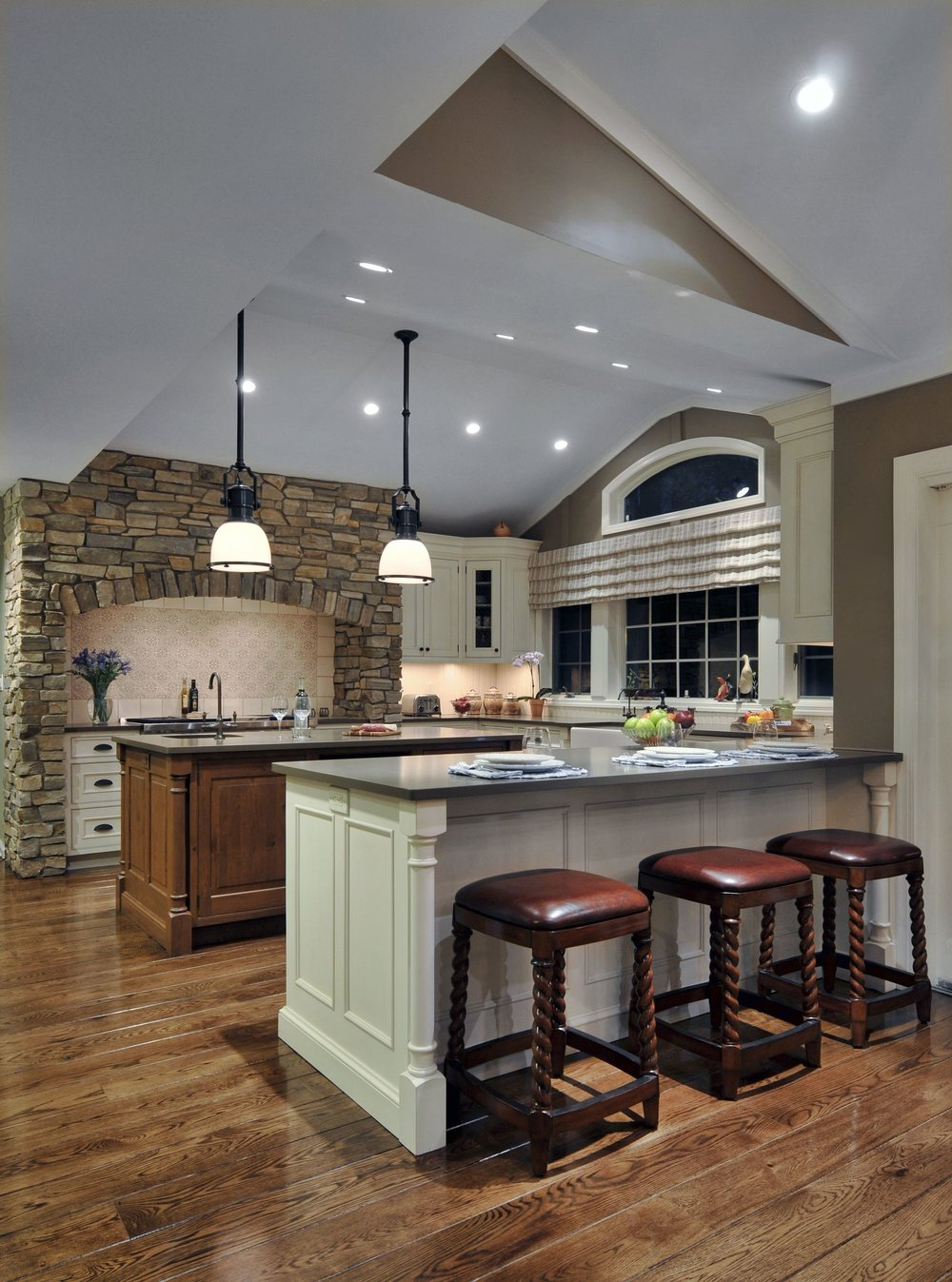 Traditional style kitchen with three wooden bar stools
