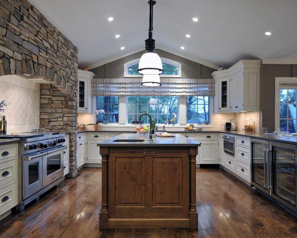 Traditional style kitchen with brick range hood