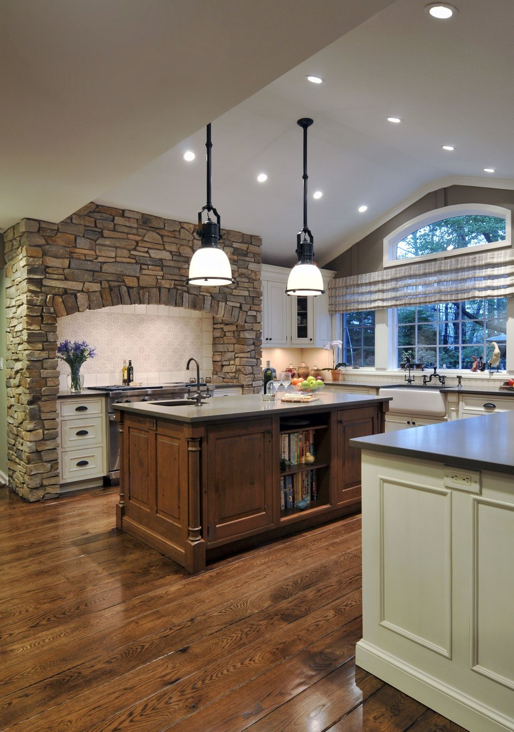 Traditional style kitchen with high ceiling and warm light setting