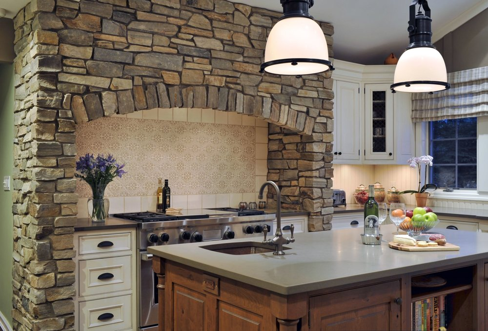 Traditional style kitchen with stainless steel range oven