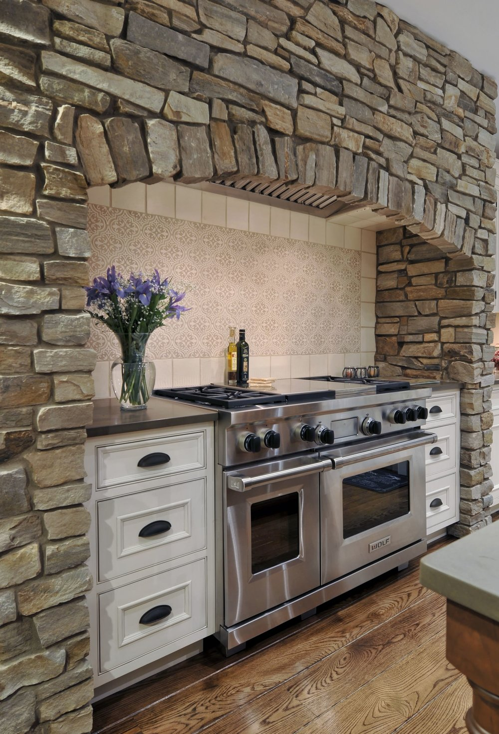 Traditional style kitchen with brick hood and stainless oven